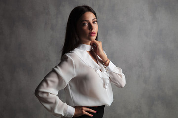 businesswoman standing with hnd on waist and neck