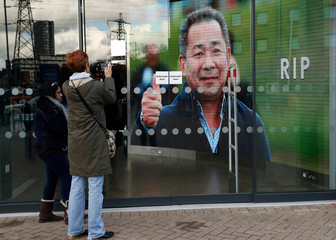 A picture of Leicester City's owner Thai businessman Vichai Srivaddhanaprabha is projected on a giant screen inside the stadium after he and four other people who died when the helicopter they were travelling in crashed in Leicester