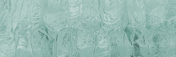 Abstract geometric texture of icy surface, transparent turquoise glass.