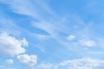 White clouds in bright blue sky (background)