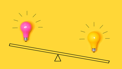 Wall Mural - Idea light bulbs on a scale on a yellow background