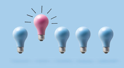 Wall Mural - One outstanding idea concept with light bulbs on a blue background