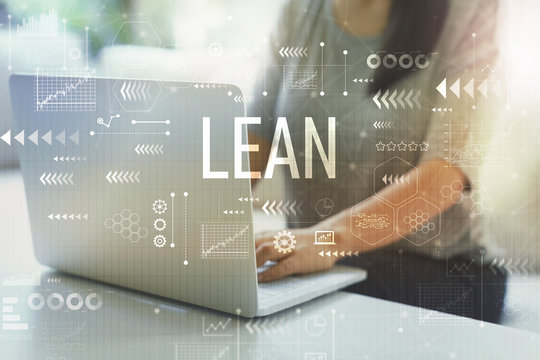Lean with woman using her laptop in her home office
