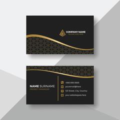 Elegant black business card with gold details