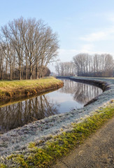 Winter landscape of the river Dyle flowing through the in frost covered countryside from Muizen to Bonheiden, Belgium