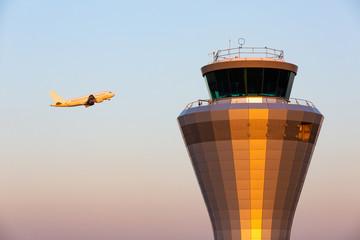 Jet Plane Pasing Air Traffic Control Tower