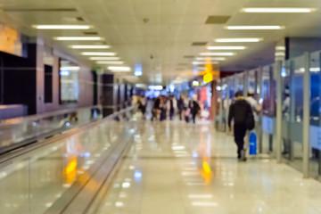 Airport corridor with passengers, defocus