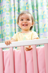 1 year old baby girl in a cradle