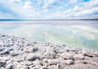 The stones are covered with a crust of salt on the shores of the salar Baskunchak. Extraction of salt