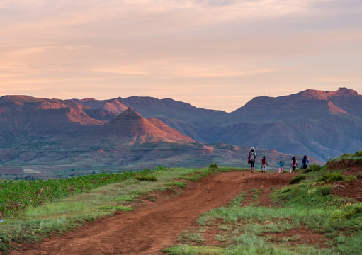 African family walking off into the sunset