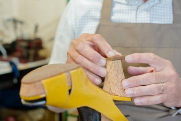 fixing a sandal's heel