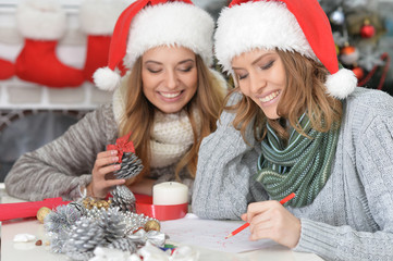 Portrait of a beautiful two women preparing for Christmas