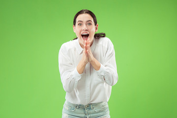 I won. Winning success happy woman celebrating being a winner. Dynamic image of caucasian female model on green studio background. Victory, delight concept. Human facial emotions concept. Trendy Wall mural