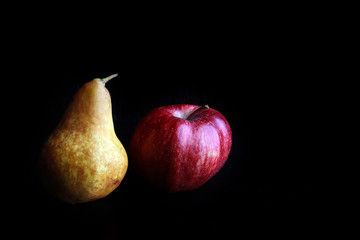 tasty juicy apples and pears on a black background