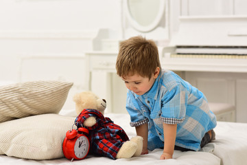 child play toys. little boy play at home. happy family and childrens day. happy childhood. Amazing day. Care and development. Little boy playing with bear. So joyful. Involved in joy