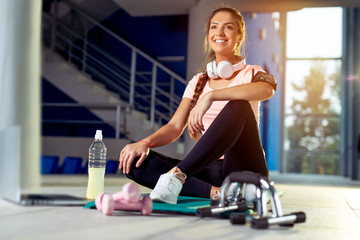Women in gym preparing for workout
