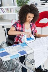 disabled beautiful woman ironing at home