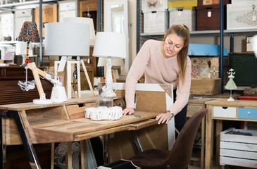 Smiling woman customer touching dressing table