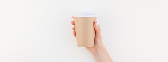 Mock up of coffee cup in female hand