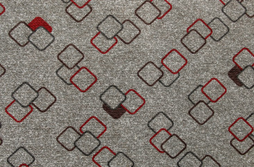 Texture of textile rug with geometric pattern of squares white and gray colors