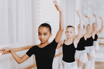 Ballet Training of Group of Young Girls Indoors.