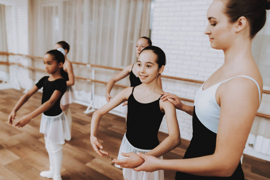 Ballet Training of Group of Girls with Teacher.