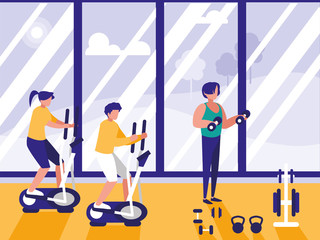 people doing spinning in gym