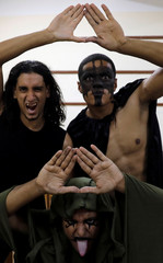"""Members of the Egyptian Arab Federation of Professional Wrestlers """"EWR"""" pose for a photograph at the class of the Abu Sultan High School before a public fight in Ismailiya"""