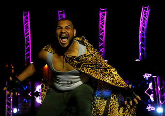 """Mohamed Samier, 28, nicknamed """"El Namer"""", meaning """"Tiger"""", a members of the Egyptian Arab Federation of Professional Wrestlers """"EWR"""", reacts before his public fight at the Abu Sultan High School in Ismailiya"""