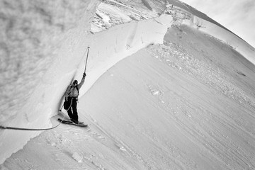Skier standing next to a mountain of snow