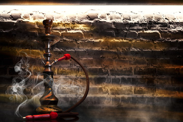 Hookah smoking on the background of an empty grunge wall, neon light, smoke, smog