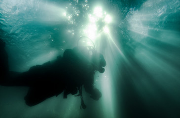 Person scuba diving underwater
