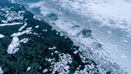 Ice breaking into pieces in a body of water