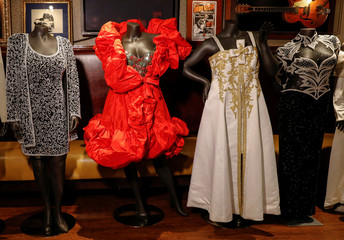 Dresses and gowns worn by singer Aretha Franklin are displayed during press preview for Julien's Auction in New York