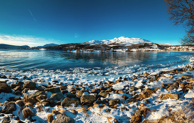 Panoramic view of beautiful winter lake with snowy mountains at Lofoten Islands in Northern Norway