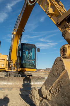 Large yellow earth moving excavator and bucket