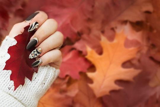 Fashion autumn nail art. Autumn background. Fashion background.