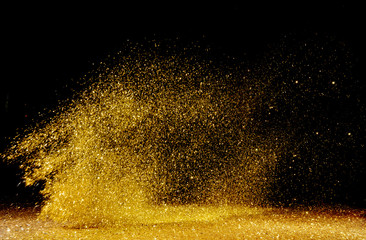 Acrylic Prints Artist KB Golden powder scattered over the dark background
