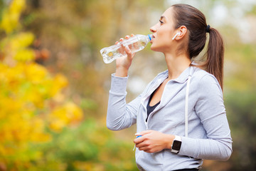 Sport outdoor. Woman Drinking Water After Running