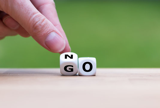 Hand is turning dice and changes the word go to no