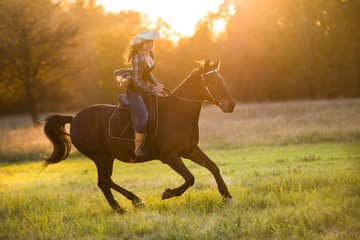 Girl equestrian rider riding a beautiful horse Wall mural
