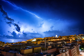 Cagliari city during a lightning storm at night