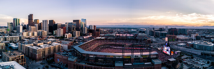 Aerial drone photo of the city of Denver skyline at sunset