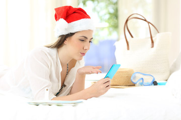 Woman on christmas holidays having a video call