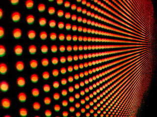 Background of colorful luminous circles, close-up of a led screen.