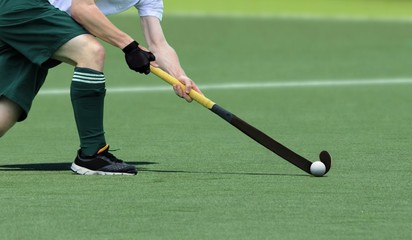 Field Hockey player, getting ready to pass the ball to a team mate.