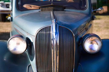 Partial close up perspective of antique car with out of focus background