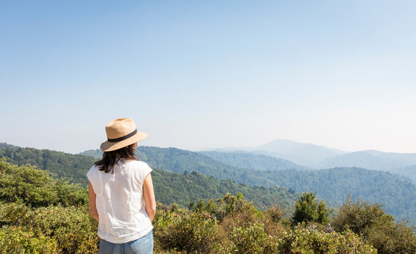 Woman looking at the view from top of mountain