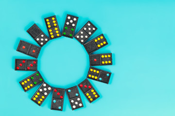 circle of domino on blue background