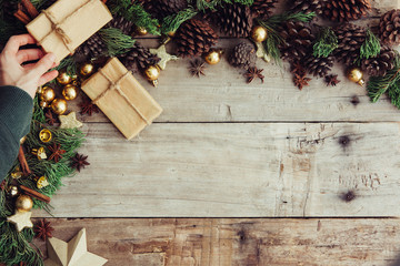 Christmas background with decorations and gift boxes on the wooden board